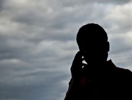 against the man who is phoning with a mobile phone