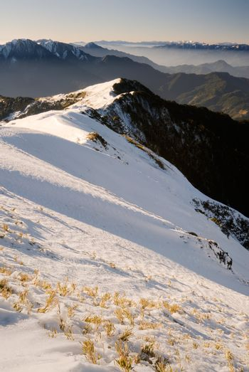 Mountain scenic of slope with grass and ice in winter in Mt Hehuan, Taiwan, Asia.