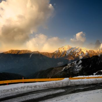 Landscape of dramatic scenery with orange sunset in snow peak in mountain Cilai, Taiwan, Asia.
