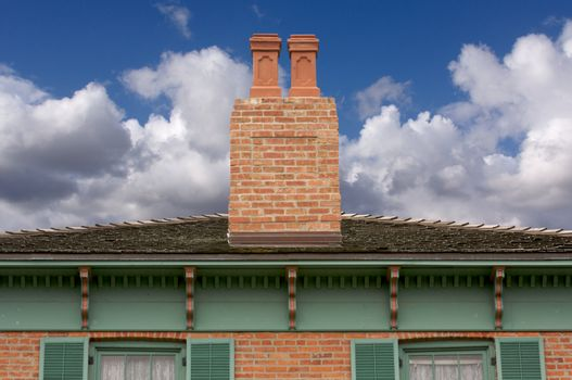 Classic Home Facade with a Dual Chimney