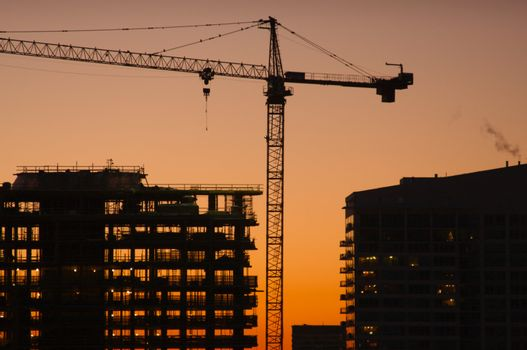 Silhouette of Crane and Building Construction Site