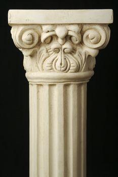 Ancient Replica Column Pillar on a Black Background.