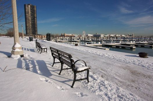 Empty Snowy Bench in Chicago After Winter Snow Along Lake Shore Drive.