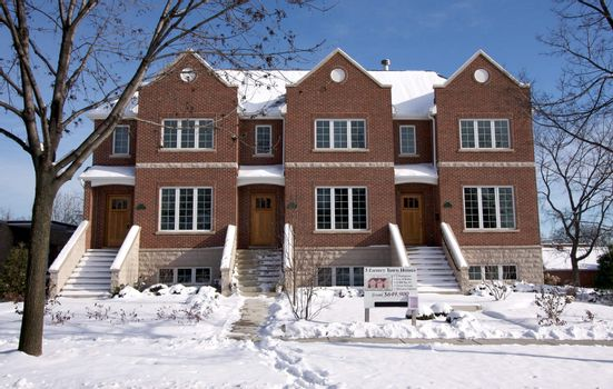 Modern Townhome Facade on a Snowy Winter Day