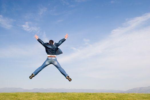 Man jumping on green field