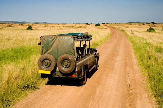 Jeep on safari in African savannah, Kenya.