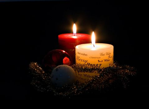 Christmas candles and ornaments on black