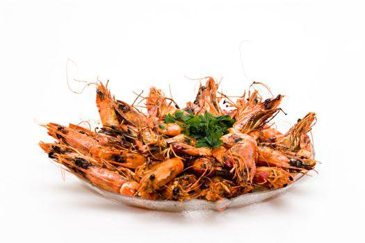 Prawn dish with parsley on white