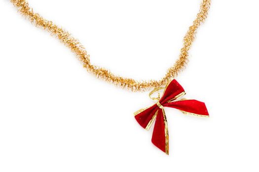Red christmas bow hang on golden ribbon isolated on white background