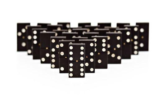 Domino pyramid on white background