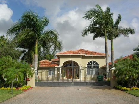 Mediterranean House With Colums, Iron Gate and Beautiful Palms Landscaping