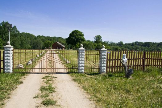 Spring day! - A farm gate and farm house in the Lithuania, Baltic States