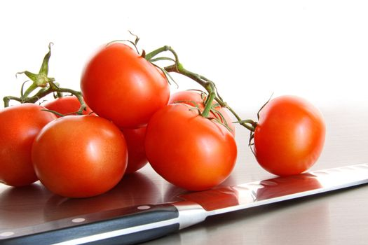 Fresh ripe tomatoes on stainless steel counter
