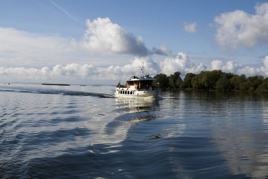 River boat in Nemunas at sunny autumn day. Lithuania