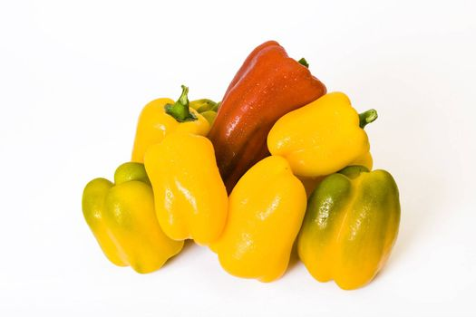 Some different paprika fruits on a white background