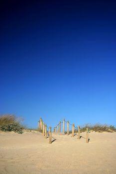 Beach scene with deep blue sky
