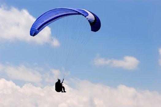 Paraglider in blue sky