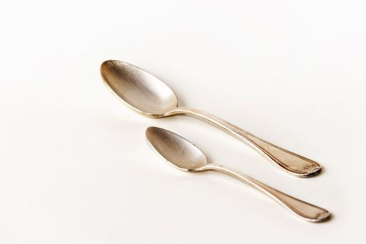 Silver spoons on white background