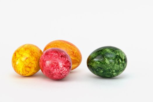 Colored eggs on white background