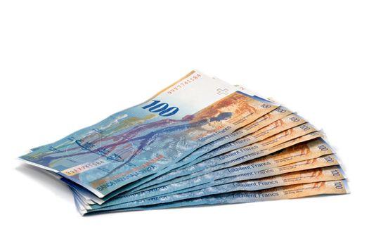 100 Swiss Franc bills isolated on white background