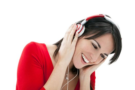 mid adult woman listening to music on white background.