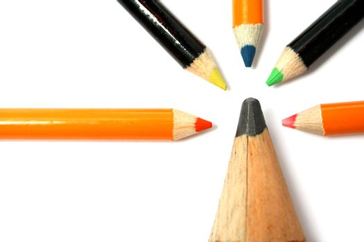 The big pencil and five small color pencils on a horizontal 5