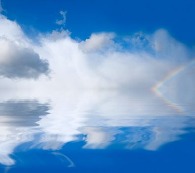 rainbow on a background of clouds and water