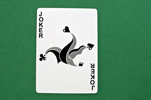 wild card in black and white on green background