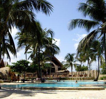 Glimpse of a typical village with pool Zanzibari