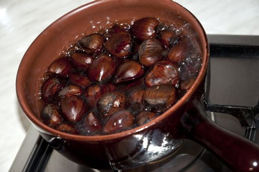 chestnuts put on a stove to boil water