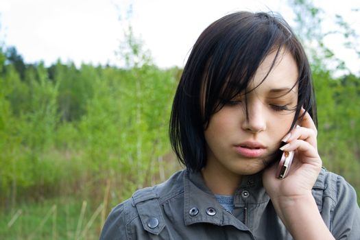 san young girl talking on telephone
