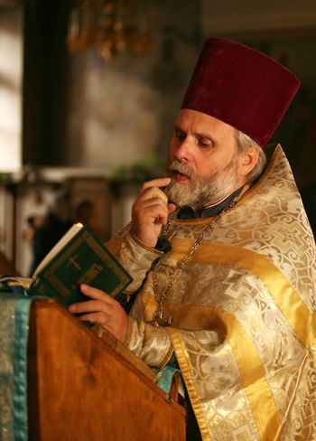 The priest with the Bible on ceremony of wedding of a newly-married couple. Moscow, the Patriarchal farmstead