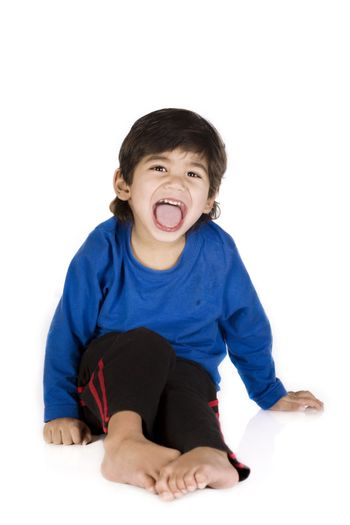 Little disabled boy sitting, isolated