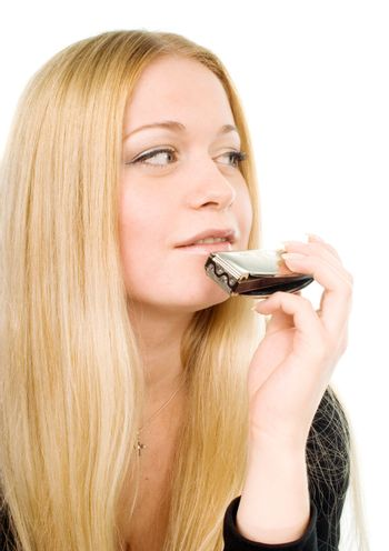blond woman with a harmonica