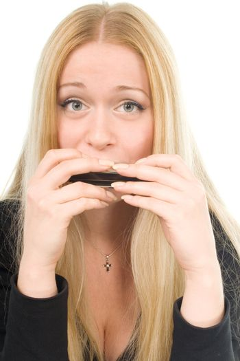 beautiful blond woman with a harmonica