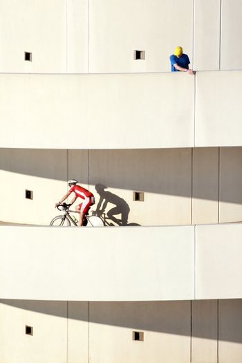 A bicyclist rides down a parking ramp in a race