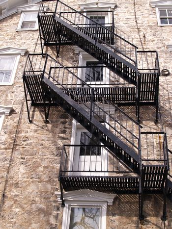 a closeup view of a fire escape for an old stone building