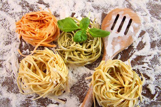 Uncooked italian pasta in three colours