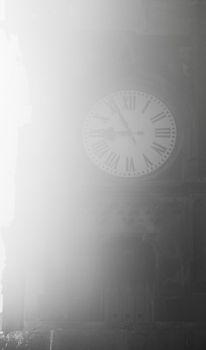 Clock in a fog
