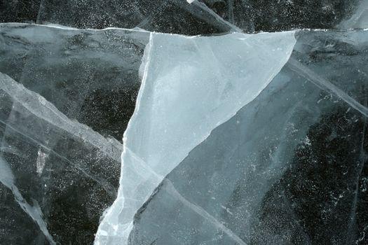 Triangular shape of a cracked ice