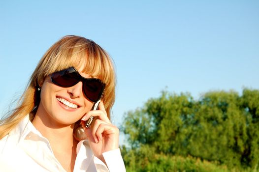 Beautiful young woman speaking the phone