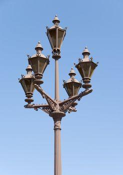 Street-lamp on a blue sky background