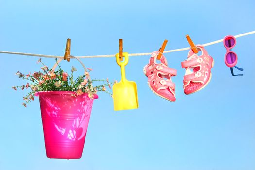 Summer toys and sandals on clothesline