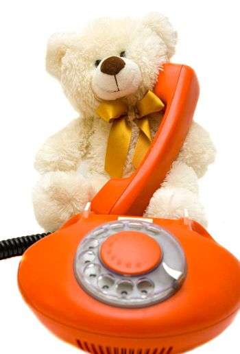 old red phone and bear toy teddy