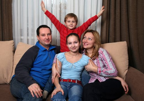Portrait of parents and children at home