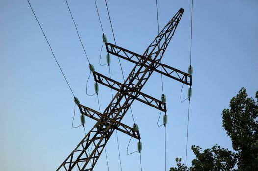 high volts power line on blue sky with insulators and wires