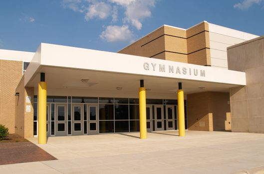exterior gymnasium entrance for a school