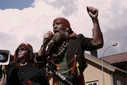 a couple of pirates singing and shouting at an annual pirate festival i Holmestrand, Norway.
