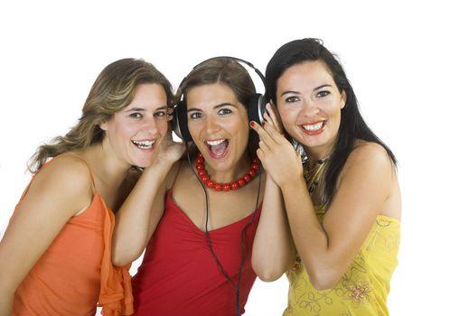Portrait of three happy girls listening music