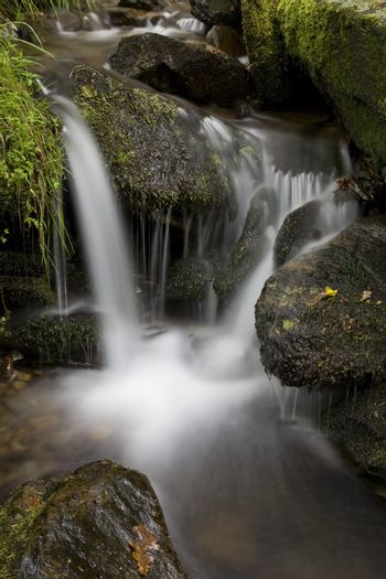 Long exposure shot of a waterfall on a creek.